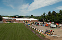 Sod covers the new practice field at Laconia High School Friday morning as crews ready the main football field for turf in the coming week.   (Karen Bobotas/for the Laconia Daily Sun)
