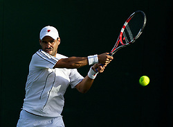 21.06.2011, Wimbledon, London, GBR, Wimbledon Tennis Championships, im Bild Alejandro Falla (COL) in action during the Gentlemen's Singles 1st Round match day two of the Wimbledon Lawn Tennis Championships at the All England Lawn Tennis and Croquet Club, EXPA Pictures © 2011, PhotoCredit: EXPA/ Propaganda/ *** ATTENTION *** UK OUT!