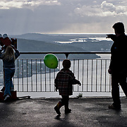 Three weeks aboard the Kong Harald. Hurtigruten, the Coastal Express. Bergen. People looking the view from Floybanen. Bergen from the top of Floybanen, the funicular.