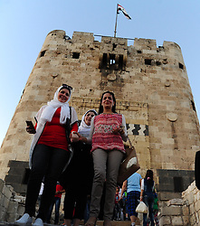 (170729) -- ALEPPO (SYRIA), July 29, 2017 (Xinhua) -- Syrian people enjoy their time near the ancient citadel of Aleppo city in northern Syria on July 28, 2017. The rebels had stayed in the east of Aleppo for five years before they evacuated in December of 2016. Seven months after the Syrian army took full control over the city, life starts to beat again through devastation and destruction in the area. (Xinhua/Ammar Safarjalani) (zjy) (Photo by Xinhua/Sipa USA)