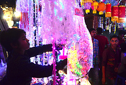 November 3, 2018 - Allahabad, India - Indian people buy decorative items and fancy lights in a local market ahead of Diwali Festival. Diwali, the Festival of Lights, marks victory over evil and commemorates the time when Hindu god Lord Rama achieved victory over Ravana and returned to his kingdom Ayodhya. (Credit Image: © Ritesh Shukla/NurPhoto via ZUMA Press)