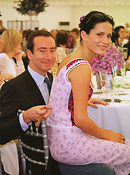The HON.ROBERT HANSON and MISS SOPHIE ANDERTON, at a polo match in Berkshire on 13th June 1999.MTD 102