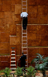 A worker repairs the fountains located in the Trump Tower while President elect Donald Trump is holding meetings on top floors of the Trump Tower, November 21, 2016, in New York, NY. (Aude Guerrucci / Pool)