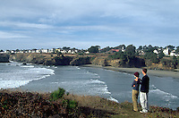 Enjoying a view of the village of Mendocino from the Headlands State Park, across Mendocino Bay, Northern CA.  CD scan from 35mm slide film.  Model released.  © John Birchard