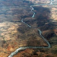 Africa, Kenya. River cuts through the wild landscape of Kenya.