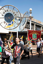 © Licensed to London News Pictures. 10/7/2014. Coventry, Warwickshire, UK. Hundreds of public sector workers held a demonstration in Coventry today. Speeches in Broadgate under the statue of Lady Godiva were followed by a march through the City Centre. Pictured, public sector workers marching through the City Centre. Photo credit : Dave Warren/LNP