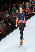 Navy pants and a wide-sleeved top with a bright tropical fishtail print on one side. By Monique Lhuillier at Spring 2013 Fall Fashion Week in New York.