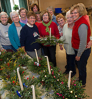 Members of the Opechee Garden Club were busy all day Tuesday assembling centerpieces and wreaths for their Holiday sale on Saturday at the Belknap Mill.  (Karen Bobotas/for the Laconia Daily Sun)