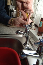 Housing Association handyman fixes a leaky tap in a flat; York