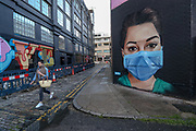 A girl walks past a recently painted mural by professional street artist David Speed and the Graffiti Life collective to show appreciation for the people who work in the NHS (National Health Service), in east London, Friday, May 1, 2020. The highly contagious COVID-19 coronavirus has impacted on nations around the globe, many imposing self isolation and exercising social distancing when people move from their homes. (Photo/Vudi Xhymshiti)
