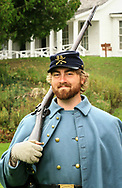 One among many soldiers, part of living history program at Fort Mackinac, one of the few surviving American Revolutionary War forts. Some soldiers at fort today carry original 45-70Springfield Model 1873, the type used at the fort during the 1880s.Photo taken Oct. 3, 2015.