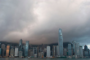 Clouds form over the peak and collect over the Hong Kong skyline at dawn. Many of Hong Kong's distinctive buildings line up including the once dominant Bank of China building. Two International Finance Centre now towers over the skyline at 88 stories 415m tall.