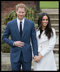 November 27, 2017 - London, London, United Kingdom - Image licensed to i-Images Picture Agency. 27/11/2017. London, United Kingdom. Prince Harry and  Meghan Markle pose for graphs in the grounds of Kensington Palace in London after their engagement announcement. (Credit Image: © Stephen Lock/i-Images via ZUMA Press)