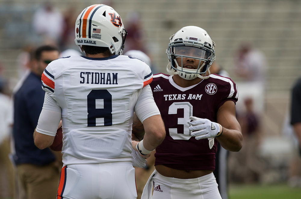 Auburn quarterback Jarrett Stidham (8) and Texas A&M wide receiver Christian Kirk (3) talk during warmups of an NCAA college football game on Saturday, Nov. 4, 2017, in College Station, Texas. (AP Photo/Sam Craft)