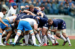 Scotland's John Barclay (right) in action during a scrum during the NatWest 6 Nations match at the Stadio Olimpico, Rome.