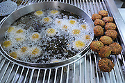 Deep frying Falafel (Small croquette of mashed chickpeas)