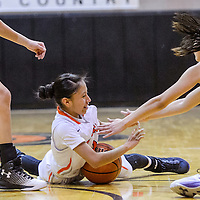 Gallup Bengal Amanda Mitchel (3) dives after the ball to keep it from Kirtland Central Bronco Talia Ockerman (3) Tuesday at Gallup High School.