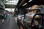 Cured meat stall at Borough Market in London, England, United Kingdom. Borough Market is a retail food market and farmers market in Southwark. It is one of the largest and oldest food markets in London, with a market on the site dating back to at least the 12th century. A farmers market is a physical retail marketplace intended to sell foods directly by farmers to consumers. Farmers markets may be indoors or outdoors and typically consist of booths, tables or stands where farmers sell fruits, vegetables, meats, cheeses, and sometimes prepared foods and beverages.