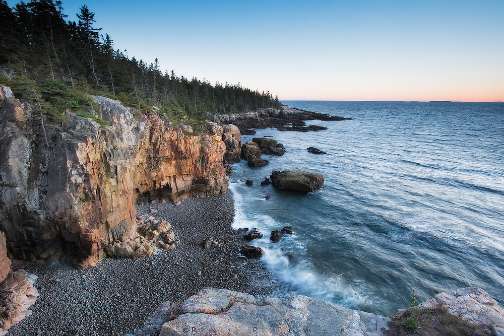 Acadia National Park, Maine.  <br /> It is sunset, and I stand high above the Atlantic on a pedestal of pink granite.  The platform is just about big enough for me and my gear, and the thoughts that I lay out and examine as I wait for the glow.  After awhile on the rock, the motion of the waves and proximity of the edge makes me feel like I'm floating.  The ocean has blasted this coast forever, and the debris of former cliffs litter this little bay. The cove below me dead ends a ways behind me, against a wall of rock, that forms a bridge of sorts, that I crossed from the cliffs to get out here. I have often climbed down the ledges and slabs of Acadia to explore a beach or cove, but the cliffs here are too sheer, and I do not see a clear way down. Sometimes it's better to look at things from a different perspective--to view as if from a raven's nest.  I know what it's like at ground level.  If I walk that beach, the walls will shelter me from the wind.  I will move on rounded stones of exquisite smoothness.  The tide will rise and recede ahead, each wave a demarcation of time.  Washing in one after another, they talk to you like a welcoming conversation. Going forward is going to the edge.  I could go back, but do I want to?  I'm lost in it, kind of hypnotized, living the dream.  But I am two people.  The other tries to see what's ahead for himself down there, and wonders if there's a direction that's safe for his journey.  That part of me sees walls that narrow my vision, watches me struggle on bad footing, hears the lies in the waves, waiting to betray me.  Rational versus emotional.  One lives in the moment, the other wants to avoid the unavoidable.  Both find no answers in the end, do they...and I ask myself, which has the better view?