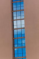 Hotel windows in vertical pattern , architectue detail image