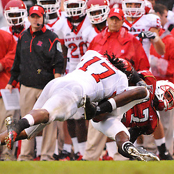 Sep 26, 2009; College Park, MD, USA; Rutgers linebacker Damaso Munoz (white) hits Maryland wide receiver Quinton McCree (red) during the second half of Rutgers' 34-13 victory over Maryland in NCAA college football at Byrd Stadium.