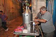 Israel, Jerusalem serving Salep at a stall in the market .
