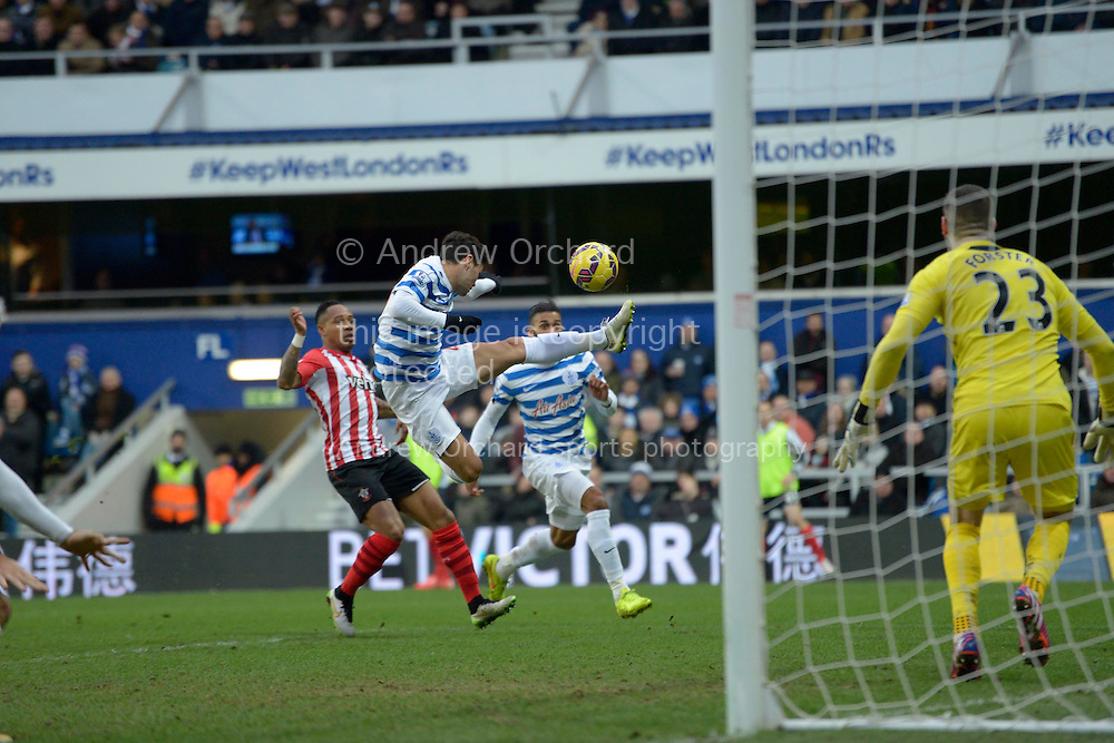 Mauro Zarate of QPR attempts to control the ball mid-air. Barclays Premier league match, Queens Park Rangers v Southampton at Loftus Road in London on Saturday 7th Feb 2015. pic by John Patrick Fletcher, Andrew Orchard sports photography.