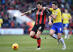 Bournemouth's Charlie Daniels and Huddersfield Town's Jacob Butterfield in action during the Sky Bet Championship match between AFC Bournemouth and Huddersfield Town at Goldsands Stadium on 14 February 2015 in Bournemouth, England - Photo mandatory by-line: Paul Knight/JMP - Mobile: 07966 386802 - 14/02/2015 - SPORT - Football - Bournemouth - Goldsands Stadium - AFC Bournemouth v Huddersfield Town - Sky Bet Championship