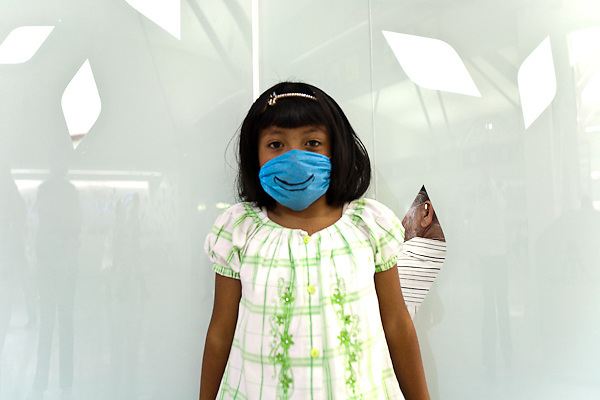 26 April 2009,  Mexico City, Mexico--- A girl wears her surgical mask at the Mexico city airport with a special style.   --- Image by © Trevor Snapp