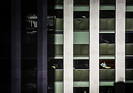 """A lone CBD office worker looks out of a high rise window during the Covid-19 pandemic.<br /> A lot of CBD offices have been closed during the pandemic with staff working from home to help """"stop the spread""""."""