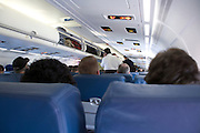 boarding business passengers making cell phone calls before airplane is going to take off