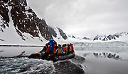 """Tourists from the vessle """"Polar Star"""" exploring glaciers in Raudfjorden, norwthern Spitsbergen (Svalbard)."""