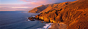 Sunset casts a golden hue over the Coast Range near Big Sur, on Highway 1 in central California.