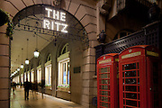 The Ritz  Hotel in London with two london red telephone boxes