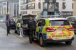 A number of armed police seen in the area around Holyrood reacting to a potential incident.