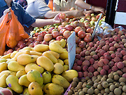 customers looking for the best produce at a fruit stand China town NYC
