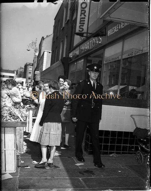 01/05/1958<br /> 05/01/1958<br /> 01 May 1958 <br /> Garda on Duty in Dublin City Centre  Garda on the beat on Moore Street, Dublin.