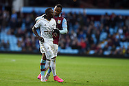Jordan Ayew of Aston Villa ® clashes with Modou Barrow of Swansea city.  Barclays Premier league match, Aston Villa v Swansea city at Villa Park in Birmingham, the Midlands on Saturday 24th October 2015.<br /> pic by  Andrew Orchard, Andrew Orchard sports photography.