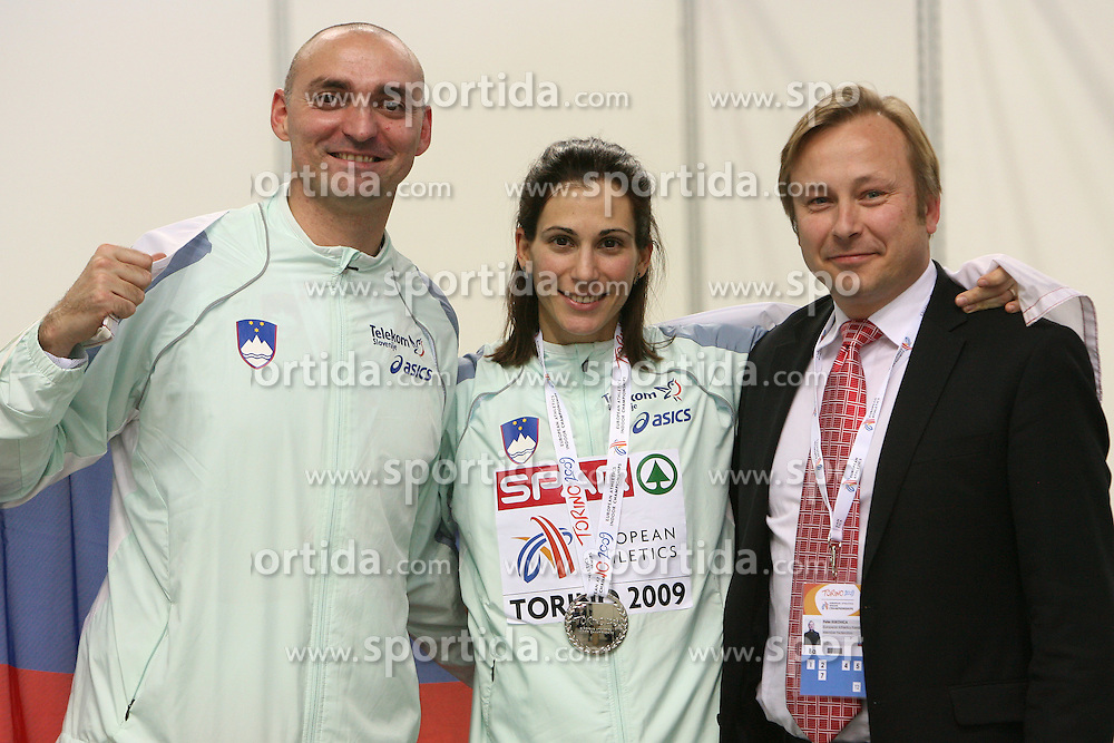 Matija Sestak, his wife Marija Sestak of Slovenia and Peter Kukovica after Marija placed second at the final of Women Triple  jump at the 3rd day of  European Athletics Indoor Championships Torino 2009 (6th - 8th March), at Oval Lingotto Stadium,  Torino, Italy, on March 8, 2009. (Photo by Vid Ponikvar / Sportida)