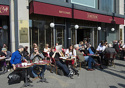 Busy street cafe at famous Cafe Einstein on Unter den Linden in Berlin Germany