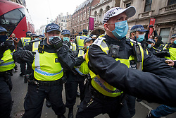 © Licensed to London News Pictures. 20/03/2021. London, UK. Police officers clash with protesters on Piccadilly during a Rally for Freedom in central London, to protest against the continued lockdown restrictions imposed to fight the spread of coronavirus. Similar events are taking place at cities around the world. Photo credit: Ben Cawthra/LNP
