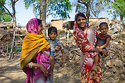 Indian villagers by farm smallholding near Ranthambore in Rajasthan, Northern India