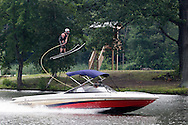 Monroe, NY  - A water ski jumpers fly through the air while being pulled by a boat during a competition at Twins Lakes Water Ski Park on July 28, 2008.