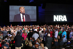 April 28, 2017 - Atlanta, Georgia, U.S. - Thousands of NRA attendees watch the keynote by President DONALD J. TRUMP on one of the giant screens in Hall A at the NRA-ILA Leadership Forum on Friday. (Credit Image: © Curtis Compton/TNS via ZUMA Wire)