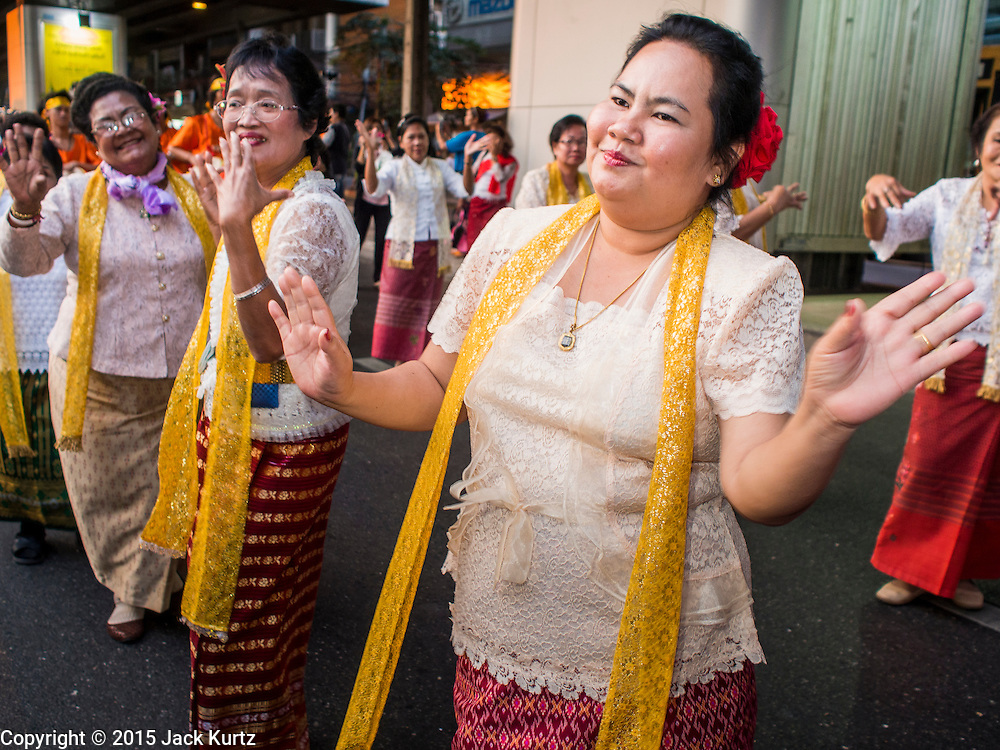 """14 JANUARY 2015 - BANGKOK, THAILAND: Women march in the 2015 Discover Thainess parade. The Tourism Authority of Thailand (TAT) sponsored the opening ceremony of the """"2015 Discover Thainess"""" Campaign with a 3.5-kilometre parade through central Bangkok. The parade featured cultural shows from several parts of Thailand. Part of the """"2015 Discover Thainess"""" campaign is a showcase of Thailand's culture and natural heritage and is divided into five categories that match the major regions of Thailand – Central Region, North, Northeast, East and South.     PHOTO BY JACK KURTZ"""
