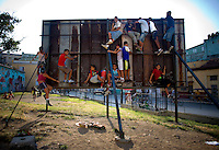 Cuban children gather on billboard