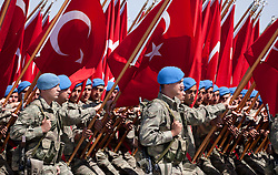 "© licensed to London News Pictures. London, UK 23/06/12. Turkish soldiers parading at the 30th August Turkish Victory Day celebrations in capital Ankara on 30/08/2011. Today the Syrian military has said it shot down a F-4 Phantom Turkish plane ""flying in airspace over Syrian waters"". Two crew members are being searched for over The Mediterranean sea. Photo credit: Tolga Akmen/LNP"