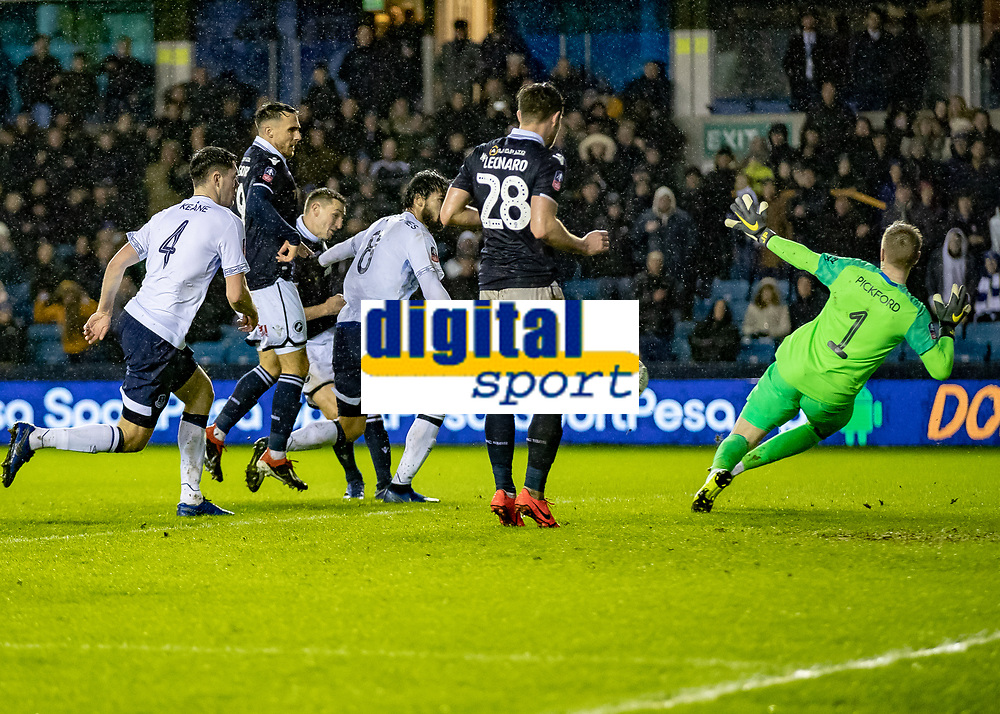 Football - 2018 / 2019 Emirates FA Cup - Fourth Round: Millwall vs. Everton<br /> <br /> Jordan Pickford (Everton FC ) saves the first effort from Millwall but can only deflect the shot at The Den.<br /> <br /> COLORSPORT/DANIEL BEARHAM