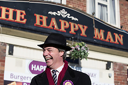 © Licensed to London News Pictures . 01/02/2014 . Manchester , UK . NIGEL FARAGE in front of The Happy Man pub in Wythenshaw . The leader of the UK Independence Party ( UKIP ) joins candidate John Bickley on the campaign trail ahead of the Wythenshawe and Sale East by-election , following the death of MP Paul Goggins . Photo credit : Joel Goodman/LNP