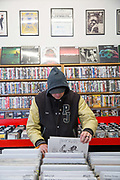 A man in a hoodie searches for new music at Flashback record shop in Crouch End on the 27th March 2018 in North London, United Kingdom.